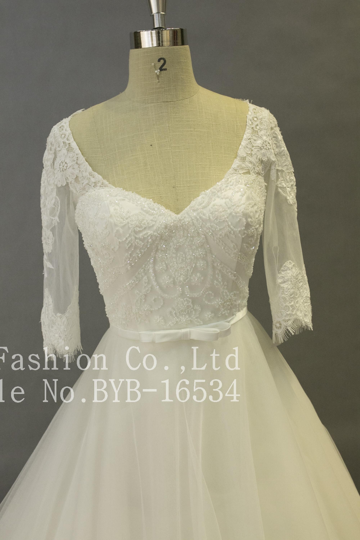db5859c746fb3 العرف فاخر الرباط appliqued الديكور الكرة ثوب ثوب الزفاف مع طويلة الأكمام