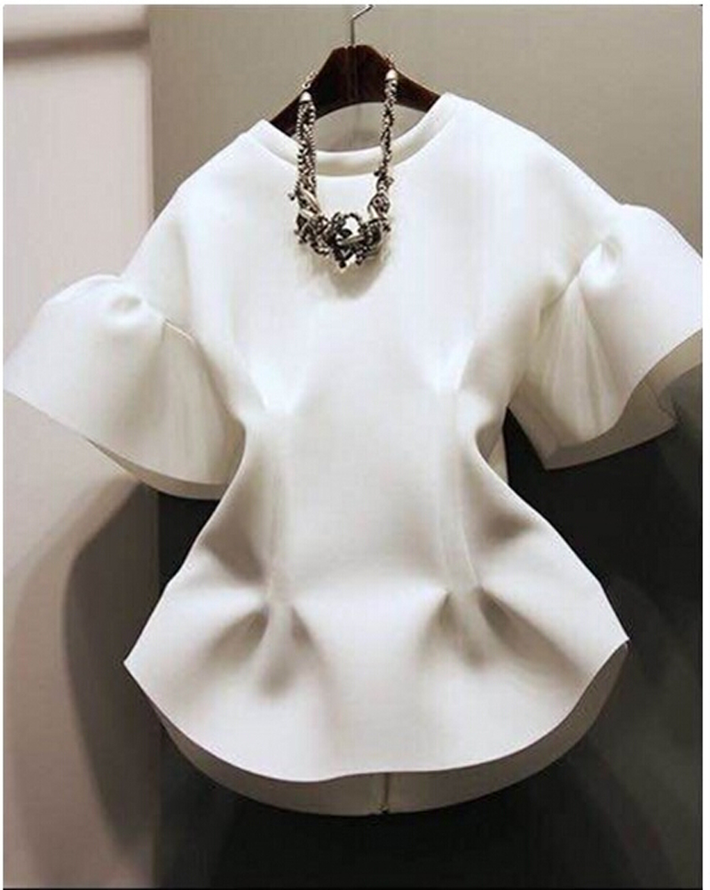And a white crop top, in particular, is the summer staple you didn't know you needed. This season, they're a bit frilly and a bit feminine, and feature elements like dramatic sleeves and gathered details.