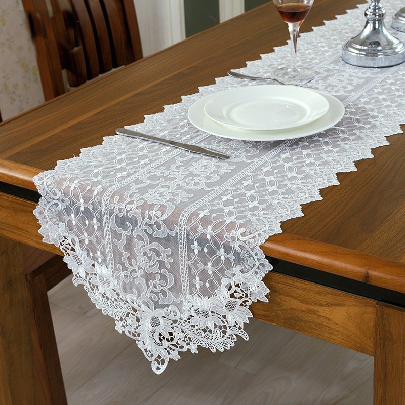 The elegant Heritage Lace Heirloom Table Runner gets its inspiration from an antique, European handkerchief of fine linen with an edge of lace. Featuring a timeless look the table runner's edge includes intricate, floral elements and deep-cut scallops.
