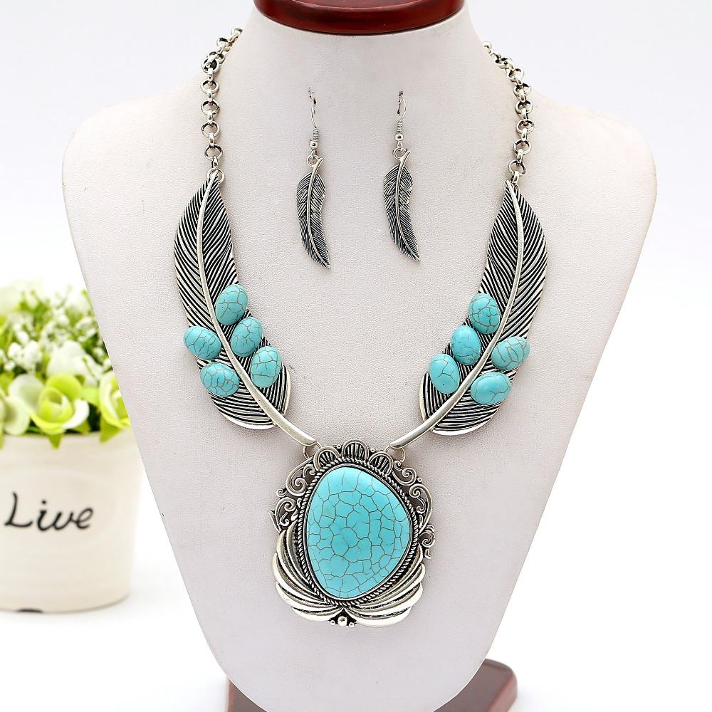 Новый дамы темперамент сплава цинка бирюзовый ожерелье свитер цепи ожерелье полый крыла перо ключицы ретро мода оптовая продажа