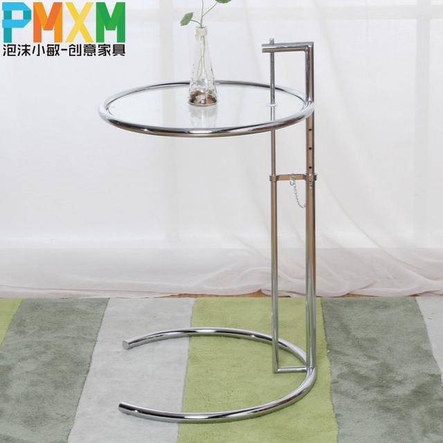 mode cr ative simple d contract table basse en verre circulaire ascenseur petite table basse. Black Bedroom Furniture Sets. Home Design Ideas