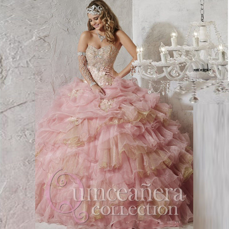 Light Pink Quin... Light Pink And Gold Quinceanera Dresses