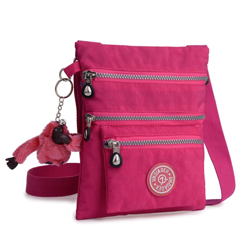 Whole Jinqiaoer Hot Fashion Waterproof Nylon Shoulder Bag Monkey Style Women Messenger Crossbody Bags For Handbags Las Leather