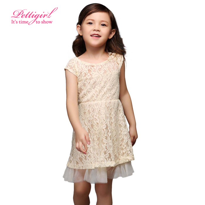 Pretty and feminine beige dress by Dolce Petit. Made in mid-weight cotton, it has ruffles, striped bows and pretty lace trim. Fully lined in lightweight polycotton, it has a fitted bodice and flared skirt, with a sash belt that ties into a lovely bow on the back.