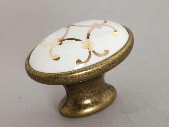 laiton antique ovale en c ramique cuisine boutons cabinet armoires armoire porte tiroir poign e. Black Bedroom Furniture Sets. Home Design Ideas