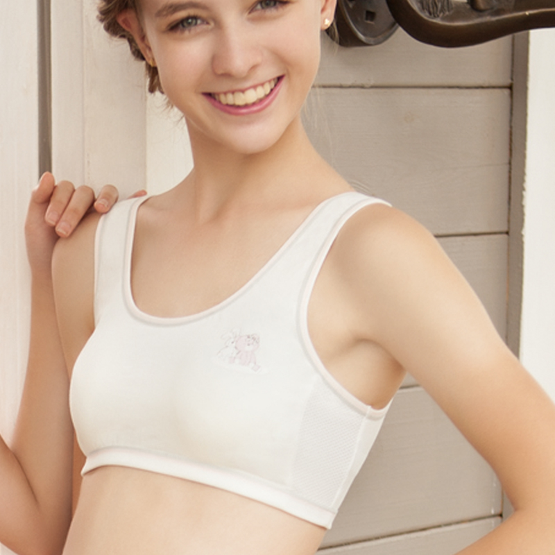 Tiny young girl first in bra with
